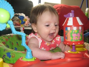 Playing in her exersaucer...she gains more and more control each day!
