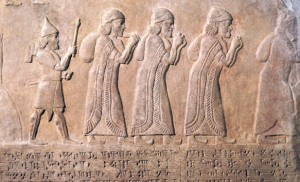 Carving depicting Assyrian Exile (you can tell by the pointy hat).