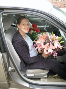 Beth laying flowers on the Camry's grave.  RIP